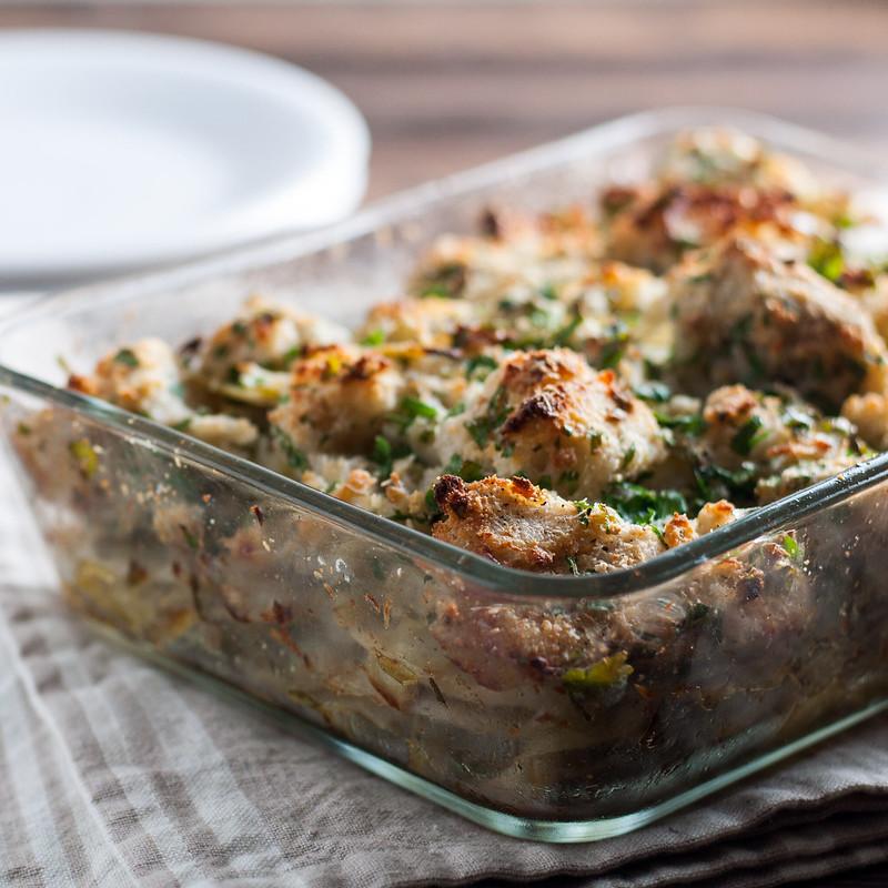 Artichoke, celery root, and potato gratin with crispy garlic bread topping