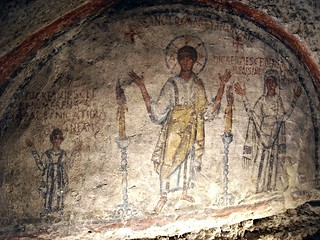 Fresco 5th century with Nicatiola, Saint January and Comina - Catacombs of Saint January in Naples - Inscriptions: left: HIC REQUIESCIT BENEMERENS IN PACE NICATIOLA INFANS; In the middle: SANCTO MARTYRI IANUARIO; Right: HIC REQUIESCET BENEMERENS IN PACE C