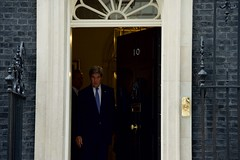 U.S. Secretary of State John Kerry departs from No. 10 Downing Street in London, U.K., on June 27, 2016, after speaking privately with British Prime Minister David Cameron following another meeting with the Secretary's counterpart, British Foreign Secretary Philip Hammond, in the aftermath of last week's 'Brexit' vote by the British people. [State Department photo/ Public Domain]