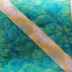 feather quilting detail