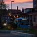 Bus in City Sunset