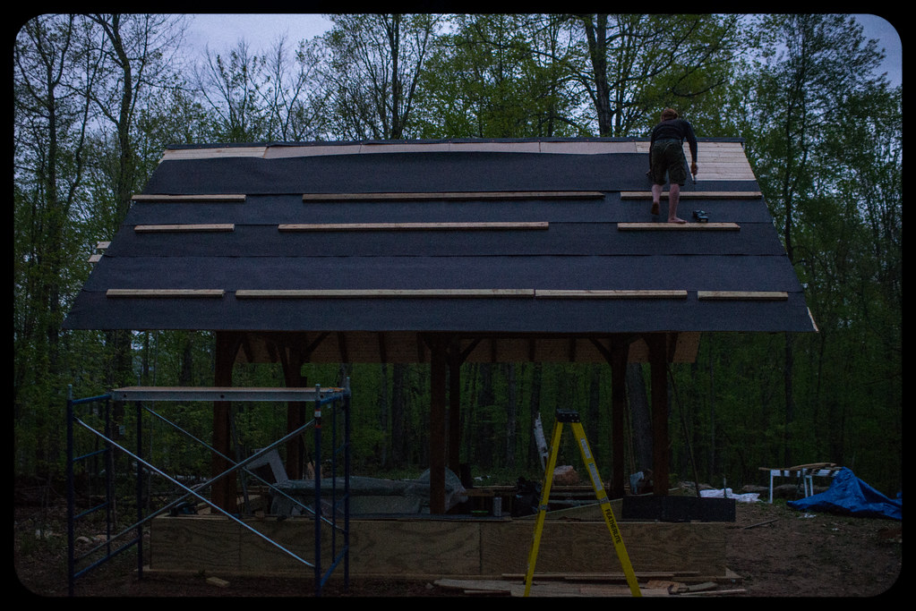 Tyler Affixing Tar Paper To Cottage Roof In The Early Morning ...