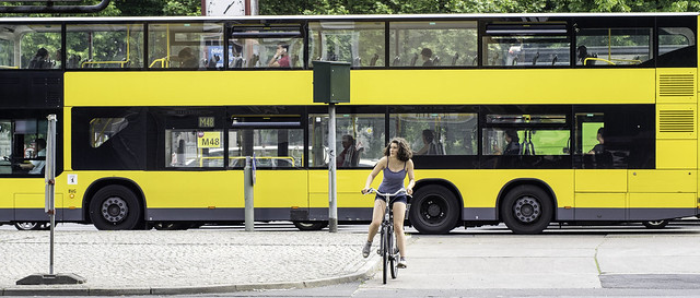 Woman on Bike; Yellow Bus