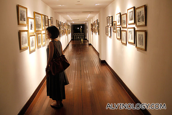 Rachel slowly strolling down the wall of fame in Raffles Hotel