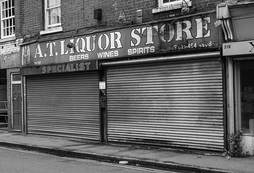 Photo of a derelict liquor store in Edgbaston with its shutters closed