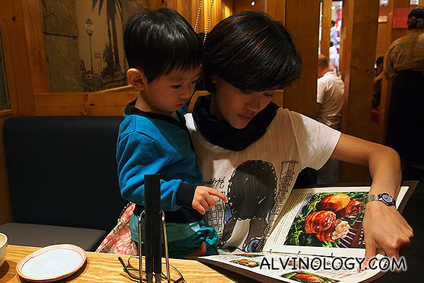 Rachel and Asher going through the menu together