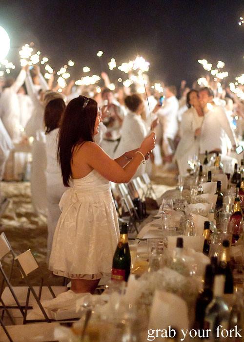 Waving sparklers at Diner en Blanc Sydney 2013 Bondi Beach