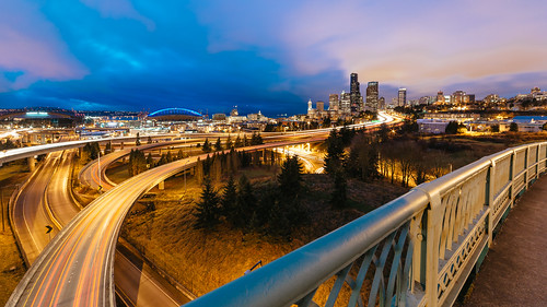 seattle city evening interstate90 highway freeway buildings cloudy downtown centurylinkfield safecostadium columbiatower drjoserizalbridge canon colorful interchange skyline cityscape longexposure trees cliché iconic wideangle interstate5 traffic roads railing night canoneos5dmarkiii samyang14mmf28ifedmcaspherical johnwestrock