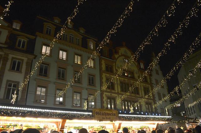 Mainz Weihnachtsmarkt lights above Gluhwein stand_lightened