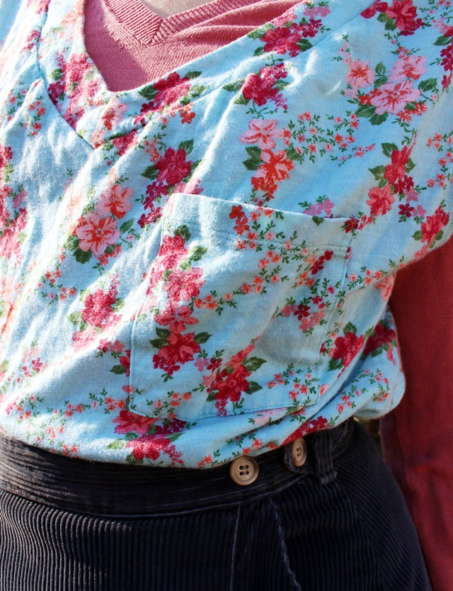 minty blue floral top over salmon v-neck sweater, navy blue corduroy skirt