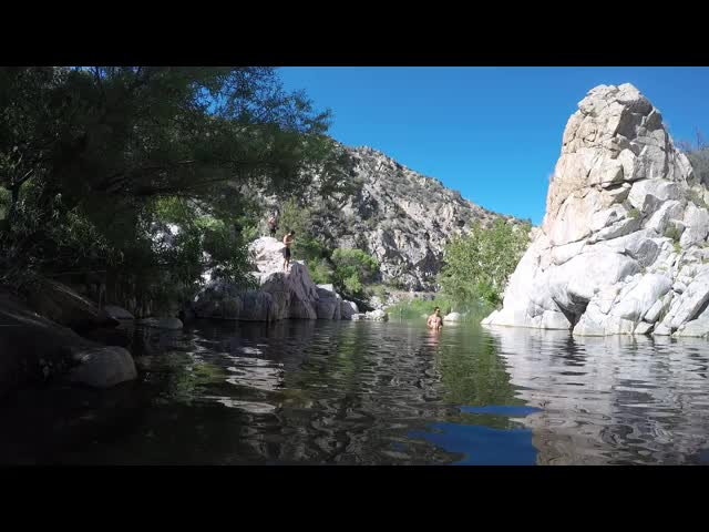 1226 Video of a man jumping into Deep Creek at Deep Creek Hot Springs