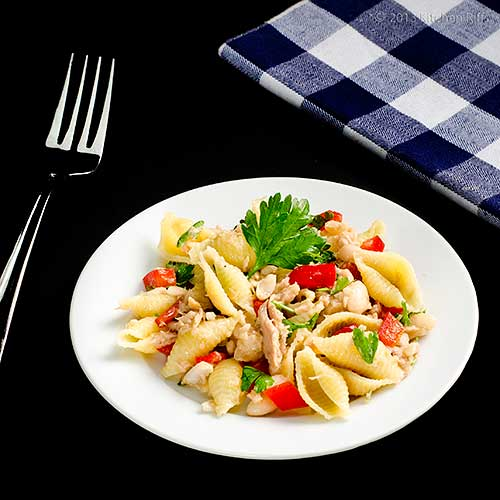Pasta, Bean, and Tuna Salad on plate, with fork and napkin