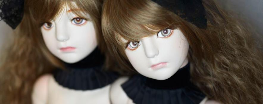 結合双生児人形