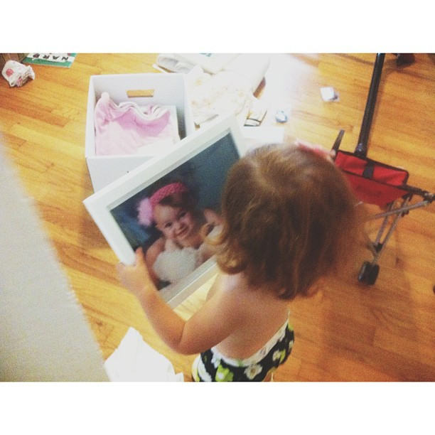 Lucy holding a picture of Margot
