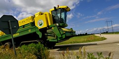 agriculture(0.0), construction equipment(0.0), crop(0.0), harvester(0.0), asphalt(1.0), farm(1.0), machine(1.0), field(1.0), vehicle(1.0), transport(1.0), harvest(1.0),