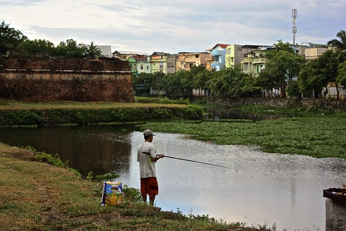 This guy is fishing in the moat of the Citadel