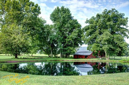 Red Barn Reflection in Pond