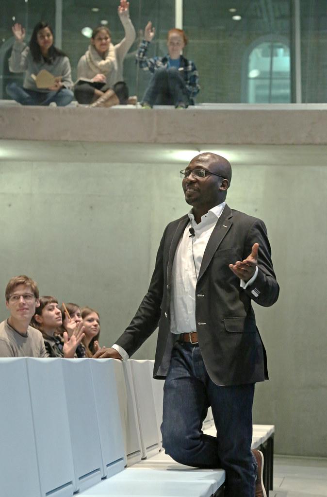 Adeyemi lecturing in Milstein Hall.