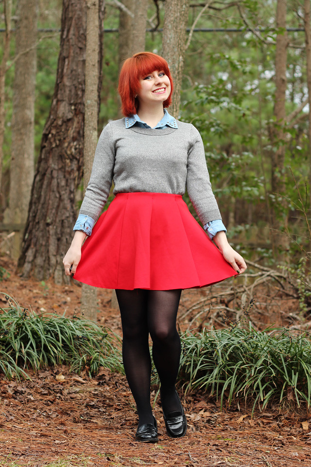 Red Skater Skirt, Silver Sweater over a Denim Button Down, Black Tights, and Patent Loafers