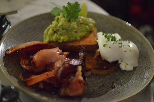 Poached eggs on toast + smashed avocado + bacon
