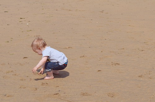 My boy on the beach by PhotoPuddle