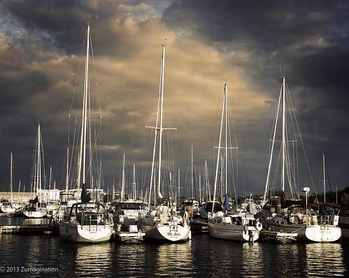 sunset sky wisconsin clouds marina docks reflections boats harbor transportation mast nautical sailboats gününeniyisithebestofday blinkagain zunikoff