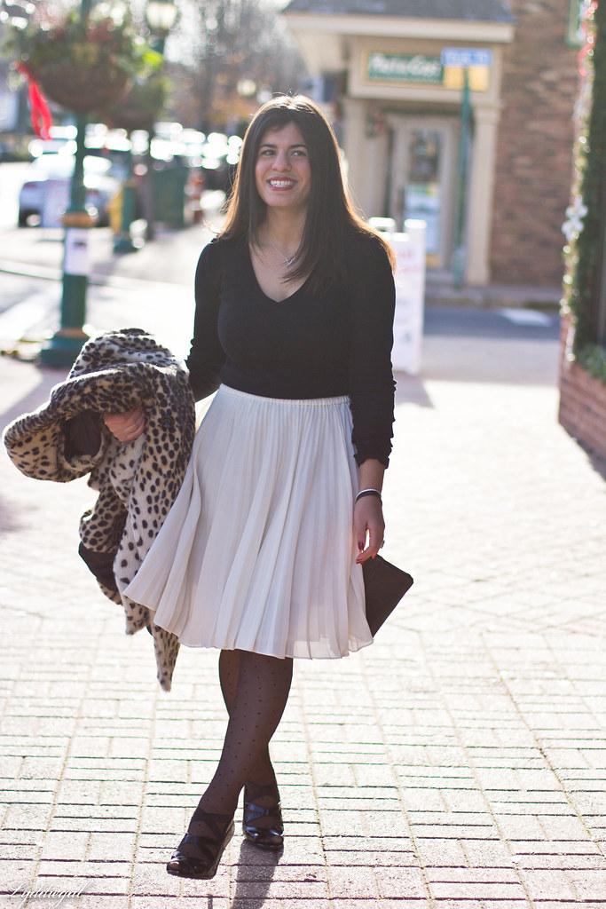 white pleated skirt black top leopard coat-2.jpg