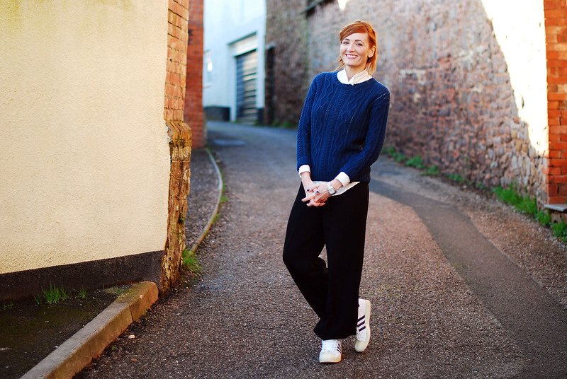 Navy sweater, loose black trousers & Adidas