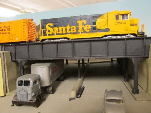 A 1970's era Atchison, Topeka & Santa Fe Railroad freight train idles above the urban viaduct. by Eddie from Chicago