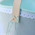 Stitching handles on laundry bag