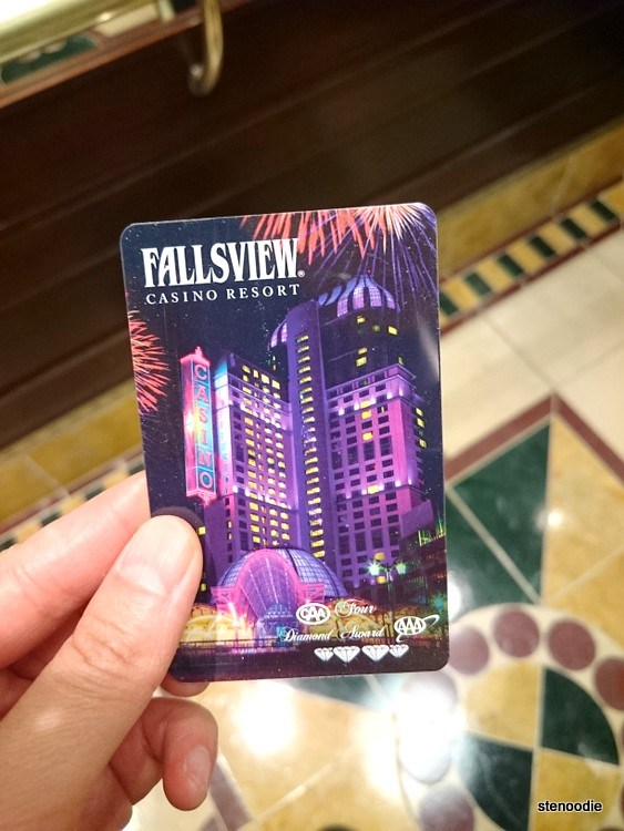 Hotel key card pictured held up above the elevator floor