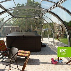 This retractable dome enclosure is perfect for protecting your hottub in any weather :-) www.sunrooms-enclosures.com