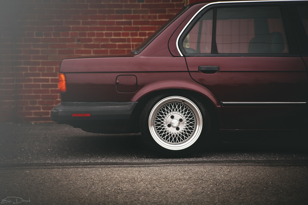 "BMW e30 325 318 with Klutch Wheels SL1 15x8.5"" silver with aggressive fitment stance and stretched tires"