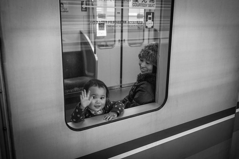 A child waving goodbye as he spotted me at Myoden Station, Tokyo.