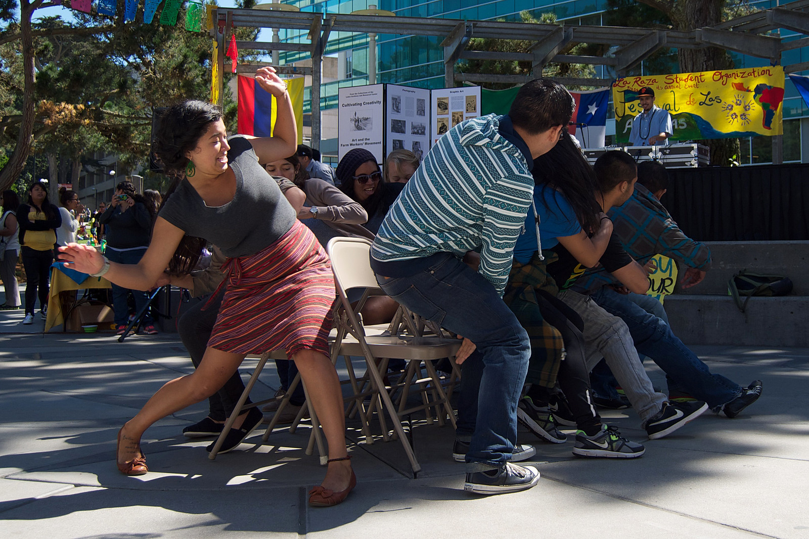 Emilytricia LÃpez Marchena misses her seat during a round of musical chairs at the La Raza Student Organization's festival in Malcolm X Plaza Sept 18, 2013. Photo by Kate O'Neal / Xpress