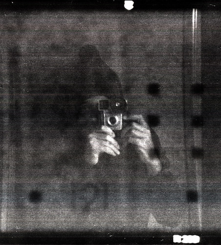 reflected self-portrait with Brownie Starmite camera and woolen hat by pho-Tony