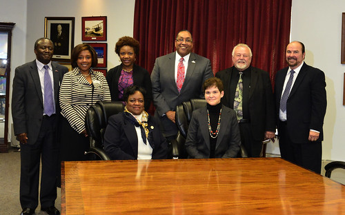 USDA Deputy Agriculture Secretary Krysta Harden (seated right) announces USDA funding for the first graduate school dorms at the University of Maryland Eastern Shore. Seated next to her is  University of Maryland Eastern Shore (UMES) President Dr. Juliette B. Bell.  (Standing) left to right, Moses Kairo, dean of UMES' School of Agriculture and Natural Sciences, UMES executive vice president Kim Dumpson; Danette Howard, the Maryland Secretary of Higher Education; Dale Wesson, UMES' research and economic development vice president; Jerry Redden, interim director - Maryland Hawk Corp. and Ronald Nykiel, UMES' chief academic policymaker. Photo courtesy of the University of Maryland Eastern Shore. Used with permission.