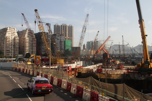Cranes tower over a massive hole at the future West Kowloon Terminus