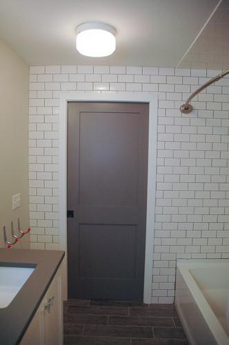 pocket door, tile wall