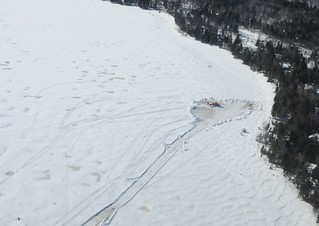 A Dolphin helicopter from Coast Guard Air Station Traverse City sits on the snow-packed shore of Washington Island, Wis. as preparations are made to recover the aircraft, March 3, 2014. The crew of the helicopter made an emergency landing safely on Washington Island Sunday morning after experiencing flight control malfunctions shortly after takeoff. (U.S. Coast Guard photo)