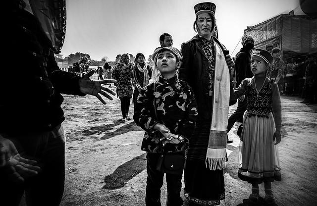 Loshar Festival; Kathmandu, Nepal, formal traditional dressed up family, kids full of curiousities of the world.
