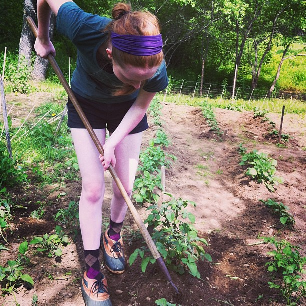 Olivia in her garden, hilling potatoes #organic #farm #homestead #teen #unschooling #maine