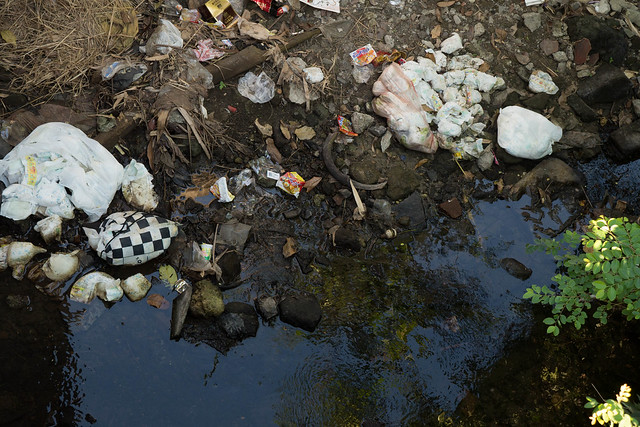 Rubbish dumped in the river in Changgu Bali, Indonesia
