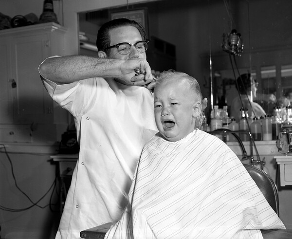 Dorian Stripling getting his first haircut in Tallahassee, Florida from Flickr via Wylio