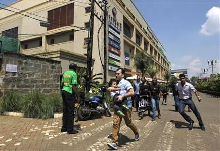 People fleeing a shooting at the Westgate shopping mall in Nairobi, Kenya. An Islamist group has claimed responsibility. by Pan-African News Wire File Photos
