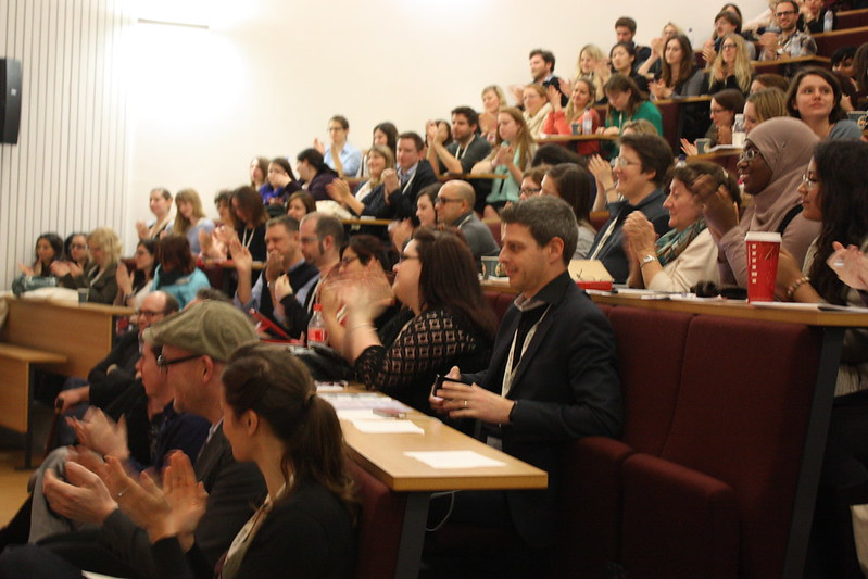 Attendees applaud at the end of the conference.