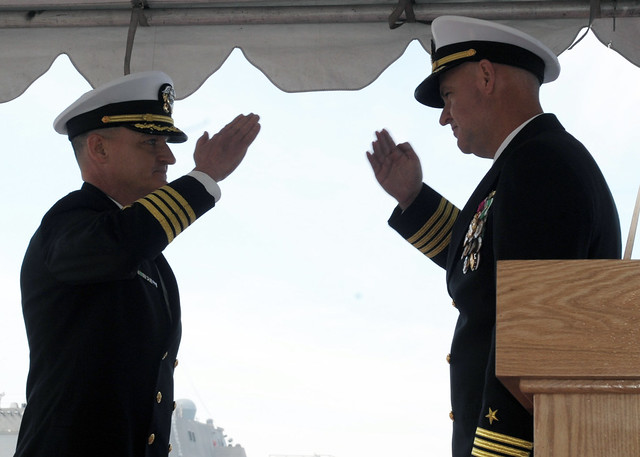 SAN DIEGO – With an exchange of salutes, Capt. Michael L. Elliott (right), Commander, Destroyer Squadron One (DESRON 1) relinquishes command of DESRON 1 to Capt. Doug Stuffle during a change of command ceremony on board the guided missile frigate USS McClusky (FFG 41).