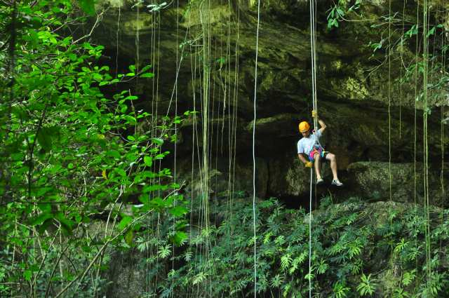 What Adventure Travel Means to Us - A Cruising Couple Rappelling into a Cenote