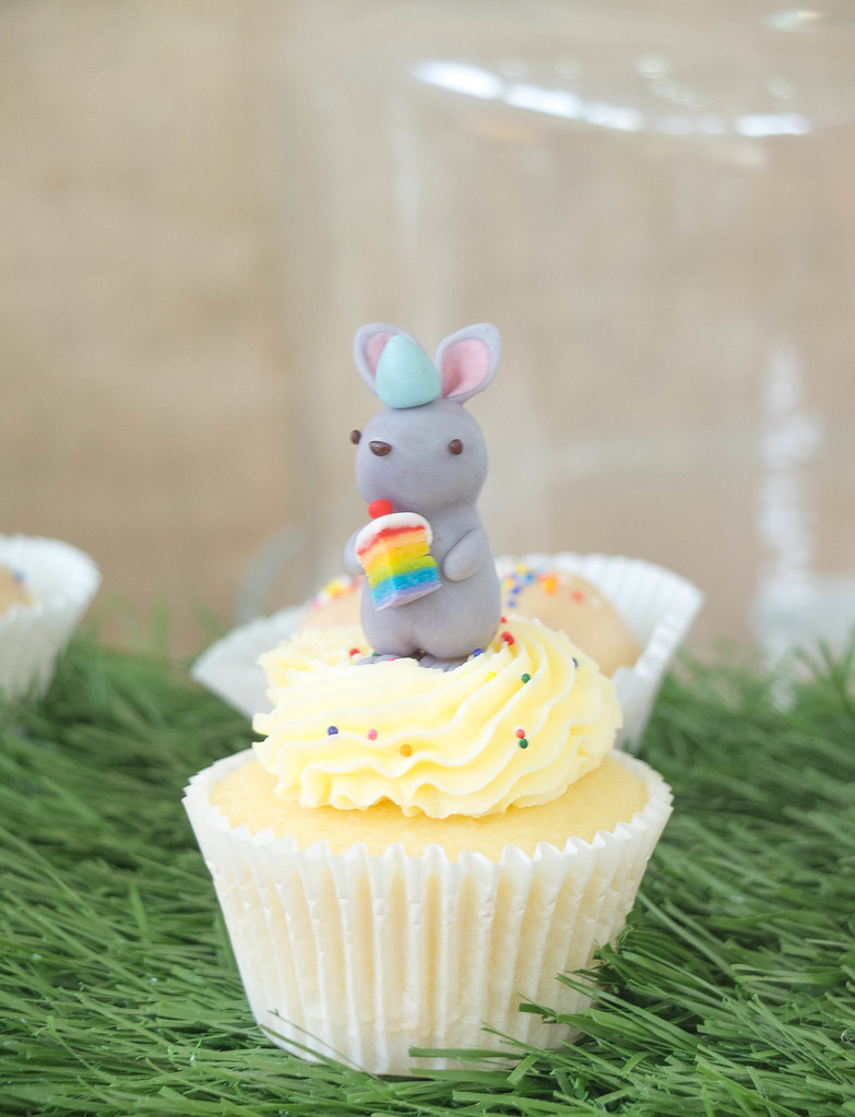 Rabbit with a slice of rainbow cake