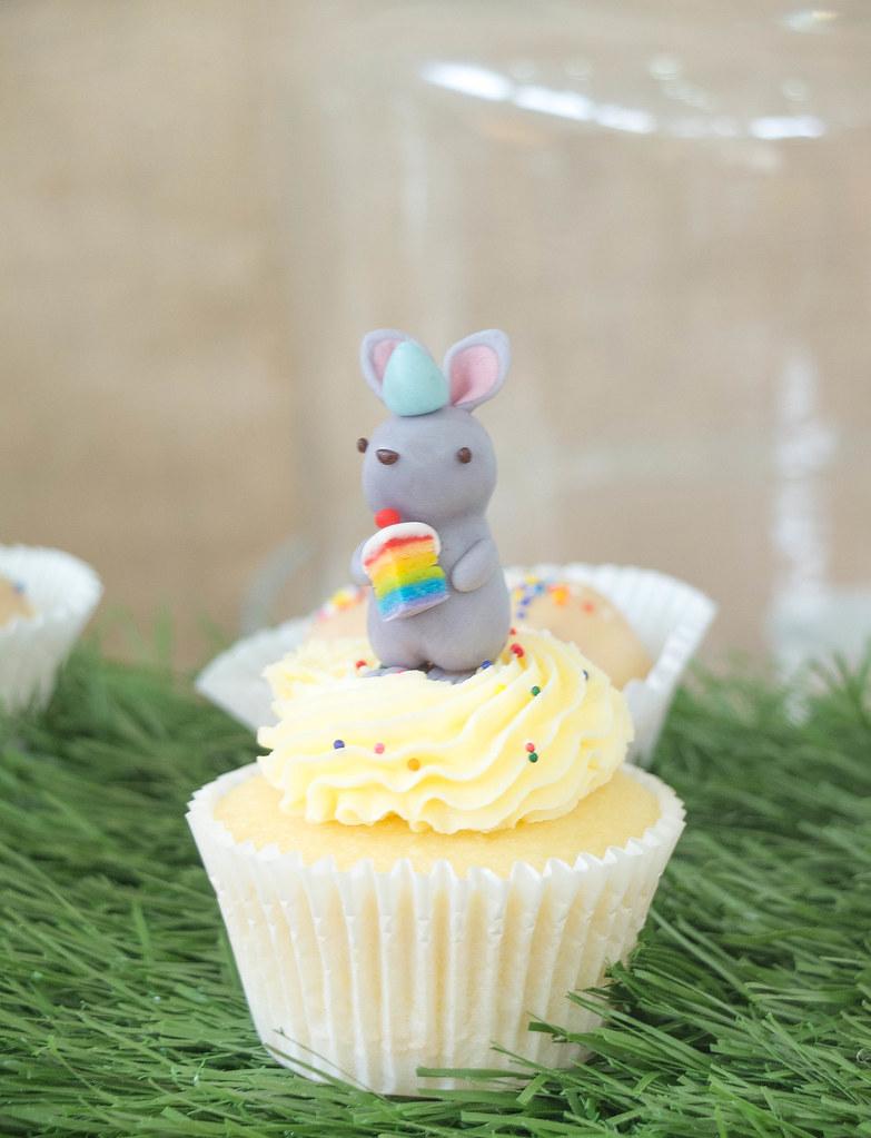Rabbit with a slice of rainbow cake